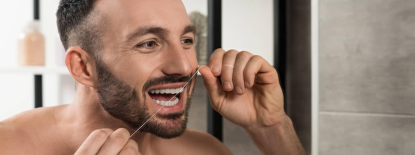 É mesmo necessário utilizar fio dentário?
